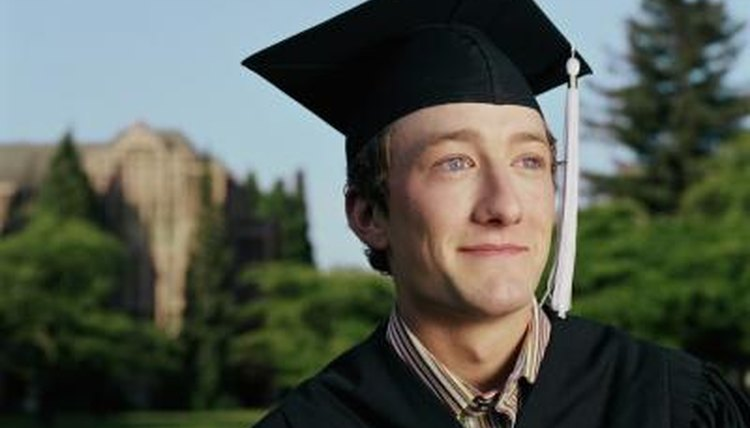 College graduate smiling in cap and gown