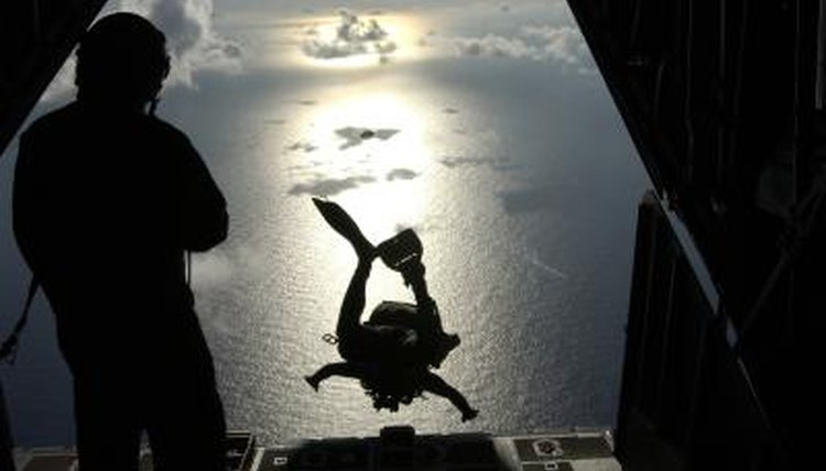 An Air Force pararescue jumper takes off from a HC-130 Hercules aircraft over the South Pacific Ocean