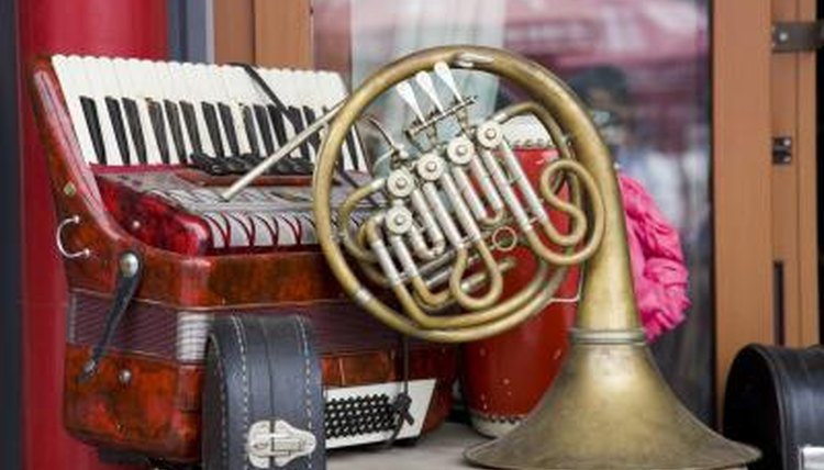 A close-up of used instruments on a small table outside of a shop.