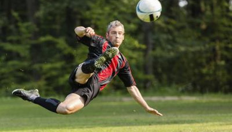 A soccer player performing a bicycle kick.