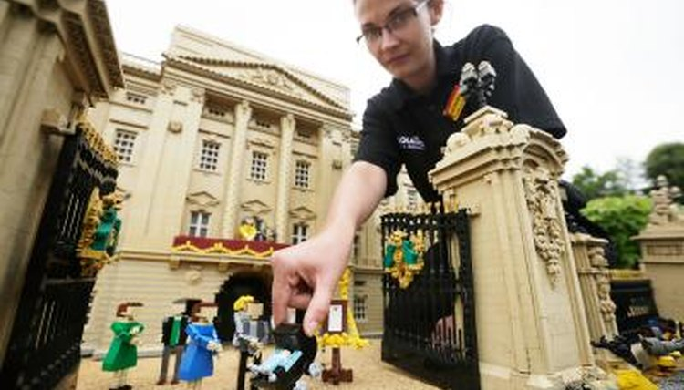 Model maker with Lego constructed Buckingham Palace