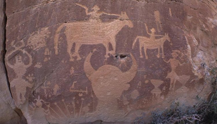 A close-up of cave paintings on a rock.