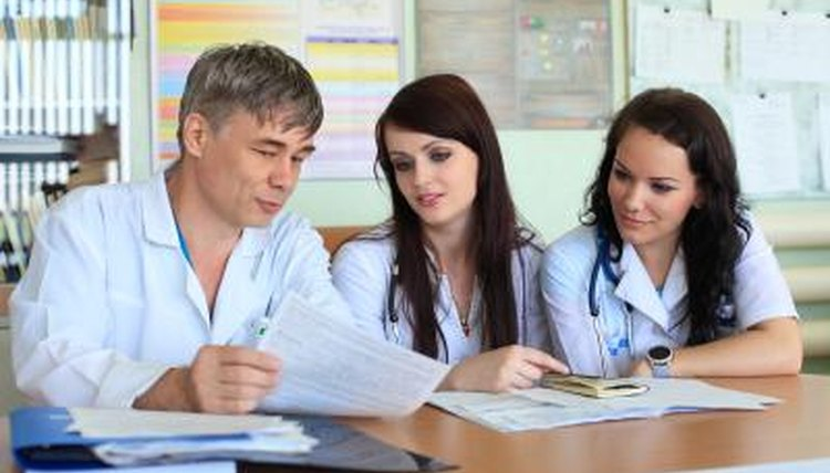 Medical school residents talking to a doctor.