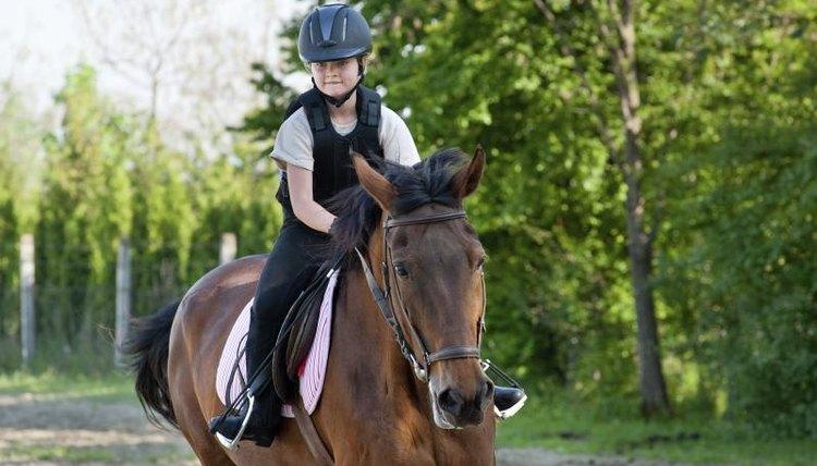 A girl is on horseback.