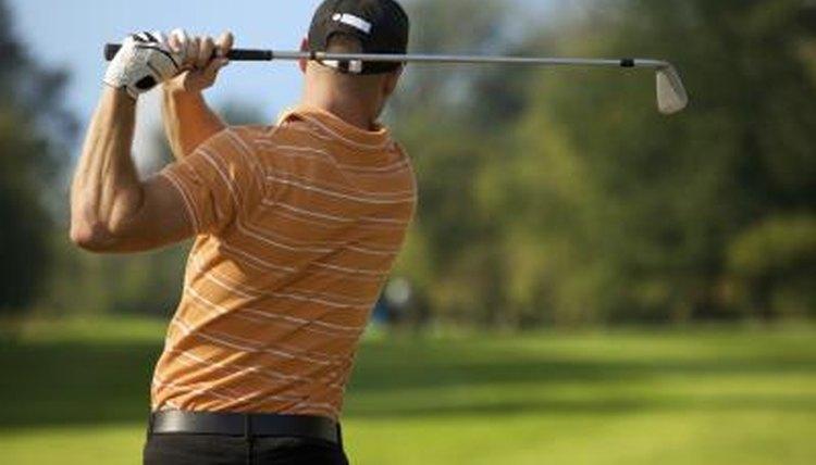 Rear view of a man swinging a golf club