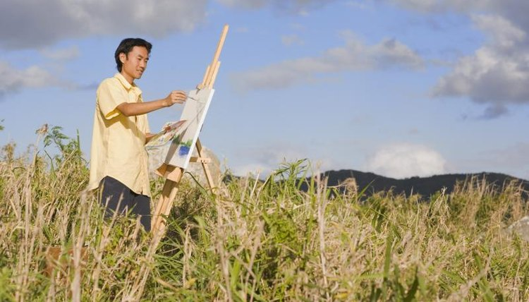 Japanese student painting in field.