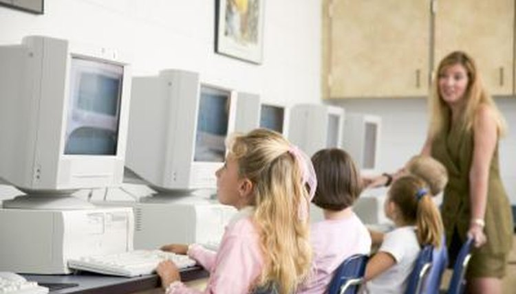 Students learn lessons using computers