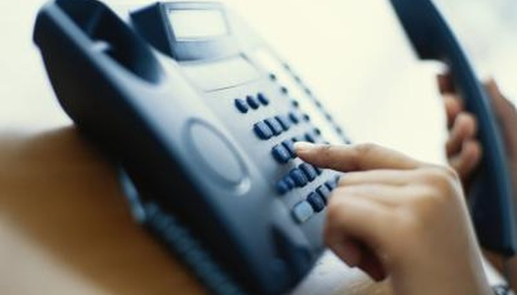 Person dialing on phone