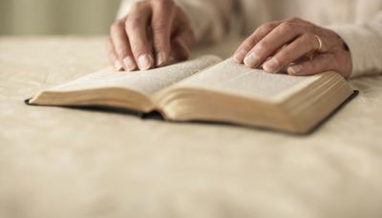Senior man reading Bible.