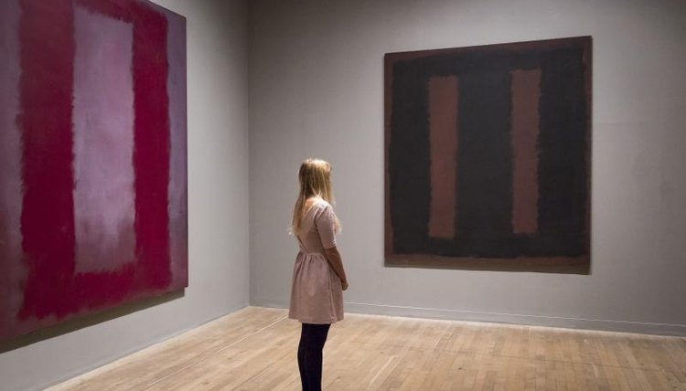 Woman looking at Rothko paintings