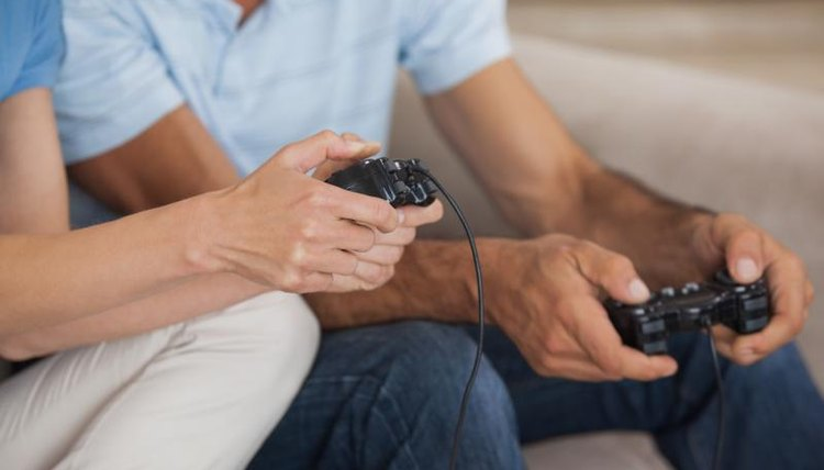 Close-up of friends playing video game