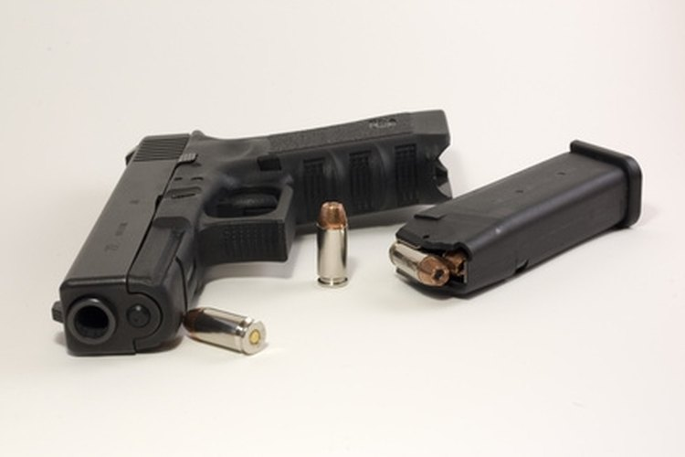 A Glock 9mm with bullets and magazine.