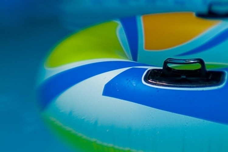Blow up a pool float to inflate it for swimming.