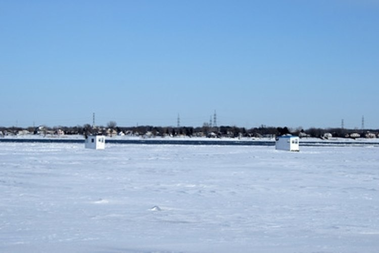Spearhouses are used as shelter while fishermen fish through the ice.