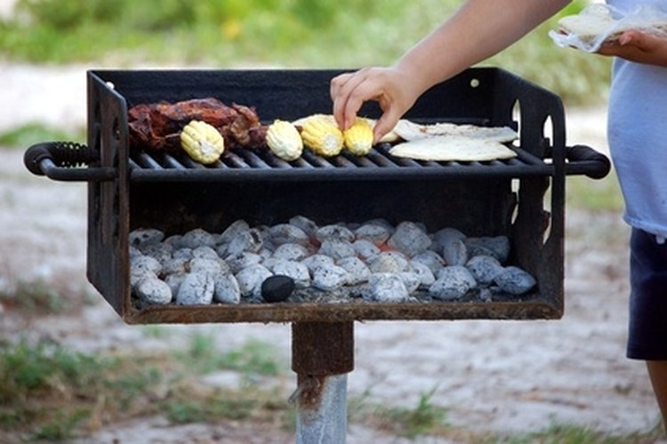 Cook your meal on a grill for easy clean up when camping out.