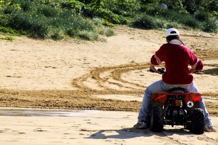 Approaching a curve on an automatic four-wheeler, slow down by reducing the throttle.