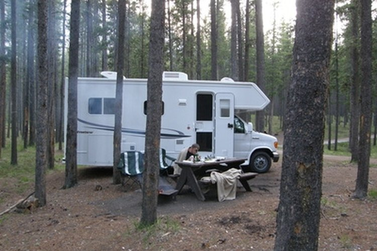 A camper-style RV with a roof not in need of repair.