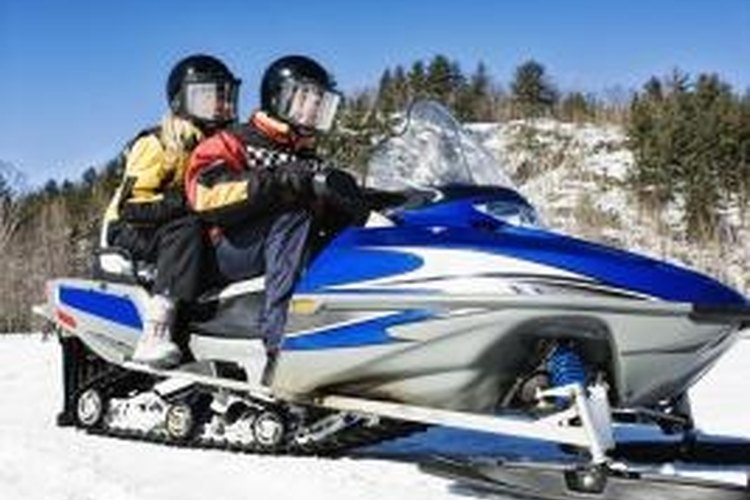 Snowmobile hand warmers supply heat via an electrical coil.