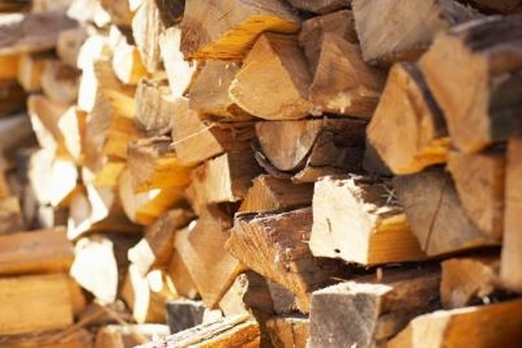 Split firewood with a wedge and sledge hammer.