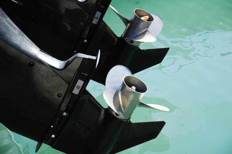 Outboard motors over the water.