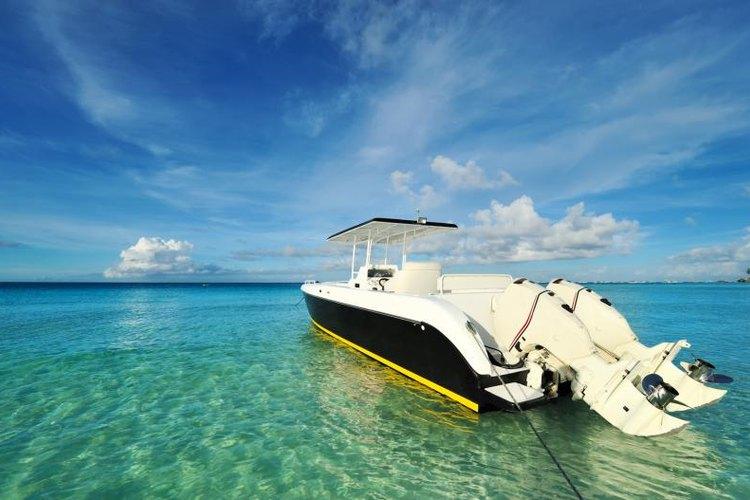 A tri-hull motor boat in the tropics.