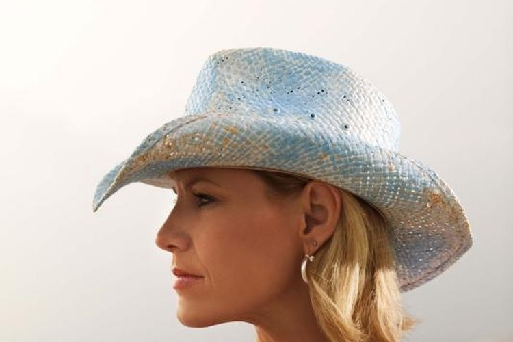Look stylish and stay safe by fitting a cowboy hat over your riding helmet.