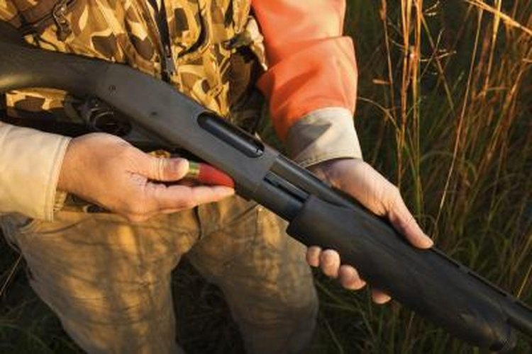 Hunter loading a rifle