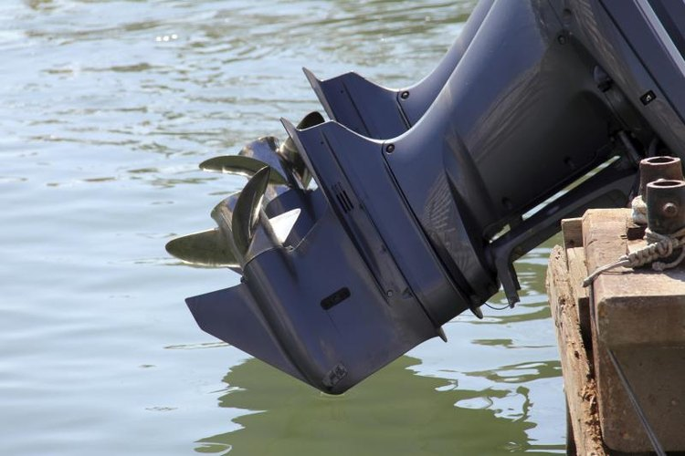 Outboard engine of boat above water.
