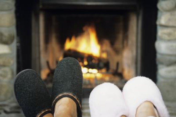 Couple warming feet by fire