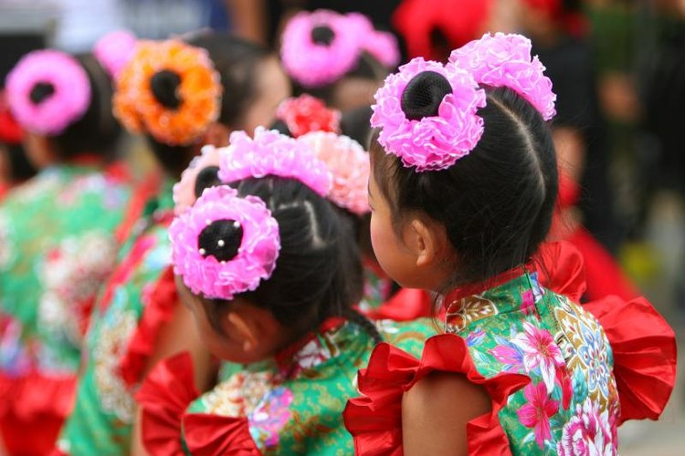 Costumes are as stylized as the moves in traditional Chinese dance.