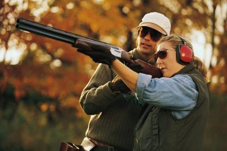Couple shooting skeet