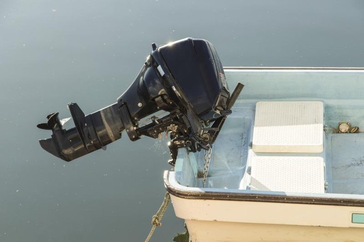 Outboard motor on the back of a boat.