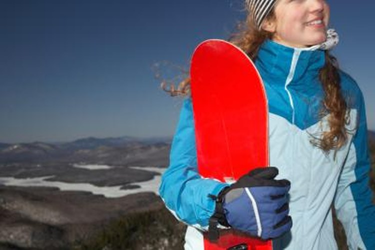 Size a snowboard by standing it up next to you.