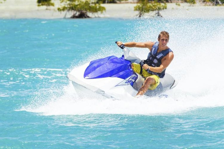Man riding a Sea-Doo in tropical waters.