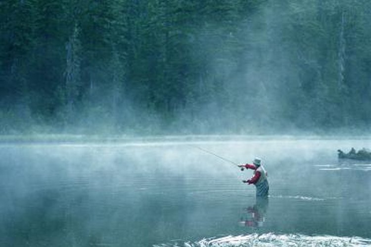 Man fishing on a small lake.