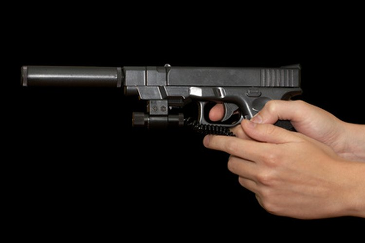 Glock pistol with silencer and laser sight.
