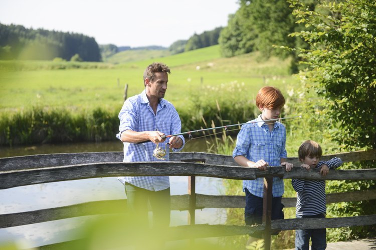 A family is fishing together.