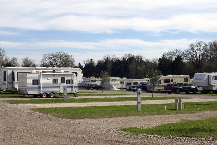A number of vehicles at an RV park.