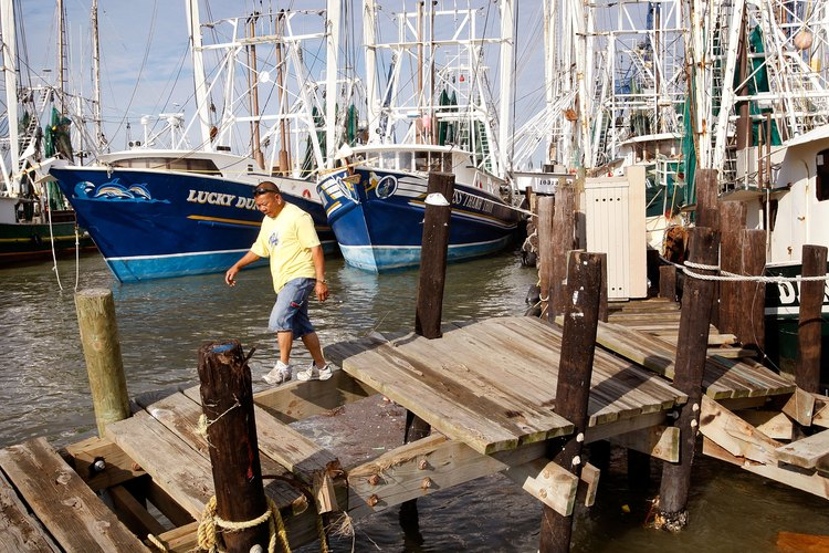A fisherman leaves his boat after a day of fishing in Galveston.