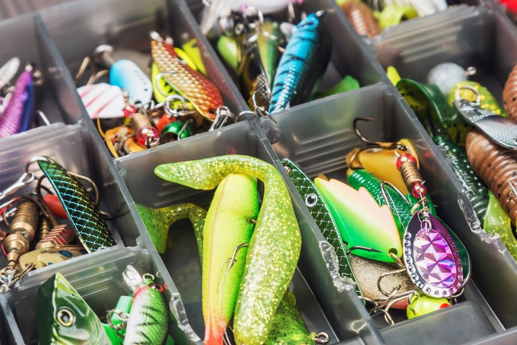 Fishing lures and accessories in a tackle box.