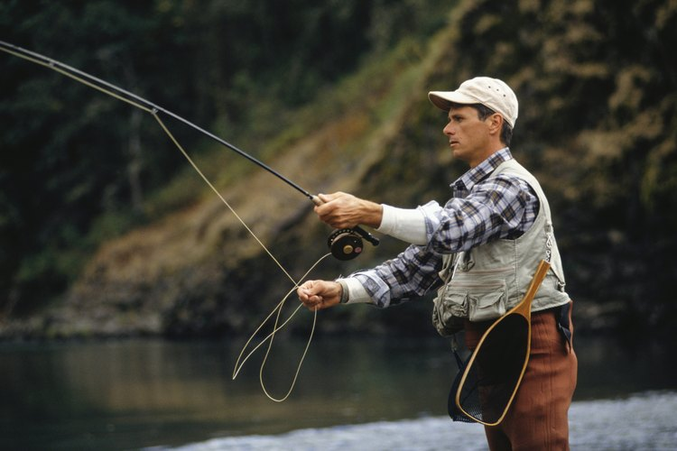 A man fly fishing in a river.