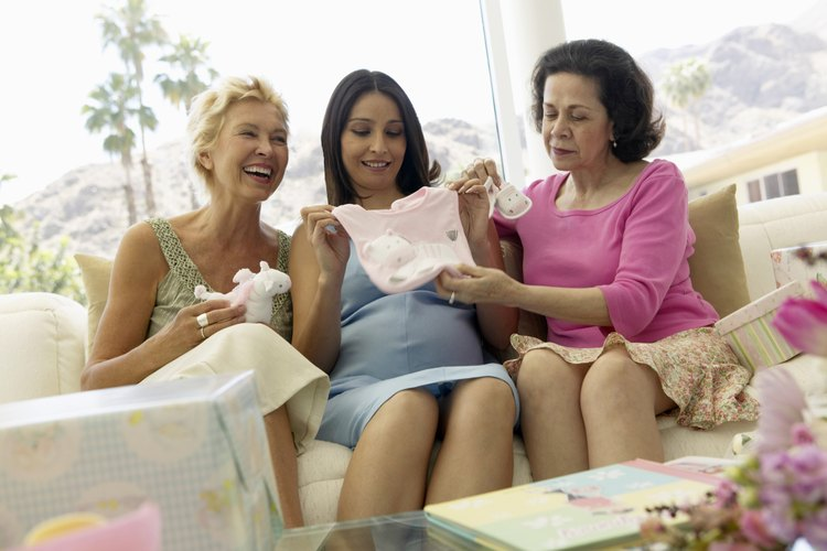 Women looking at gifts at a baby shower.