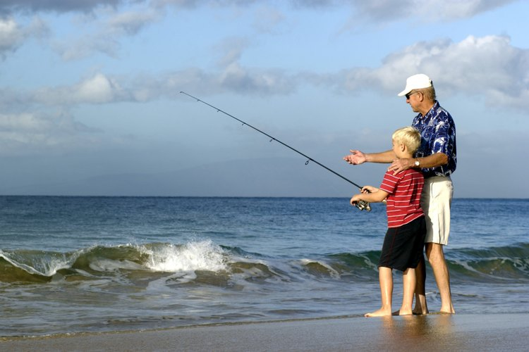 Man and sun beach or surf fishing.
