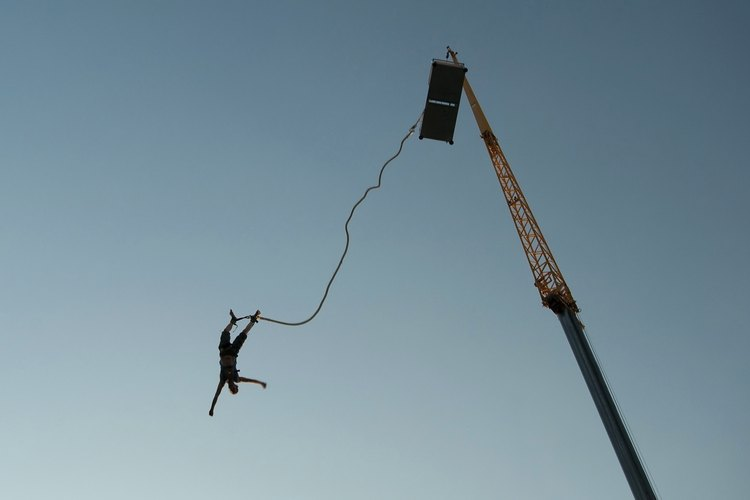 Someone is jumping from a bungee jump platform.