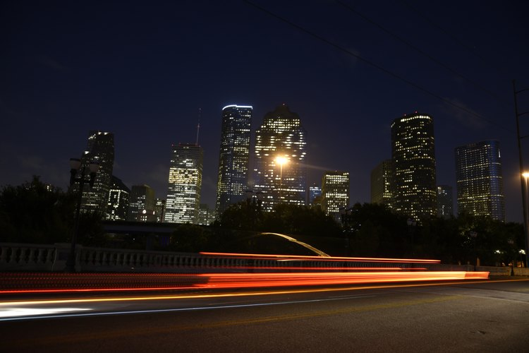 Houston Texas Skyline shown in action at night.