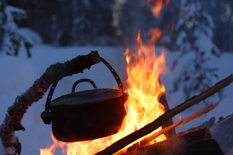 A Dutch oven is a great tool for making winter meals on a camping trip.