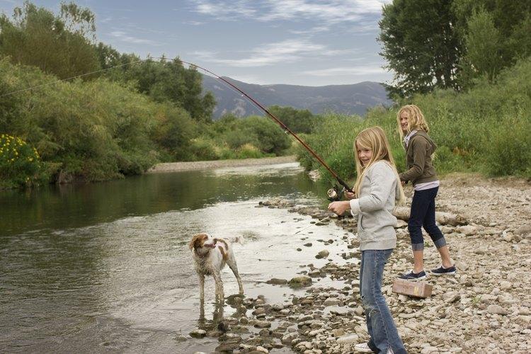 Two girls fishing in river