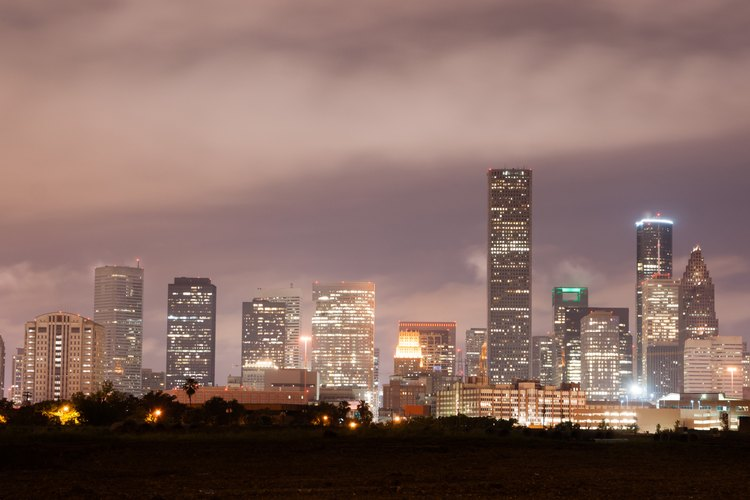 Houston skyline shown at dusk.