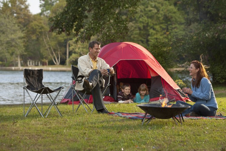 Family camping by a lake