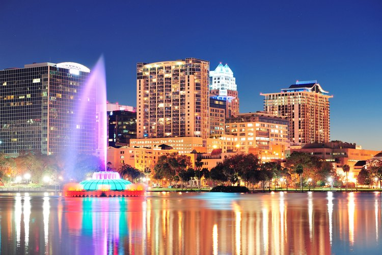 Early evening over Orlando's Lake Eola with a water fountain shooting high into the sky.
